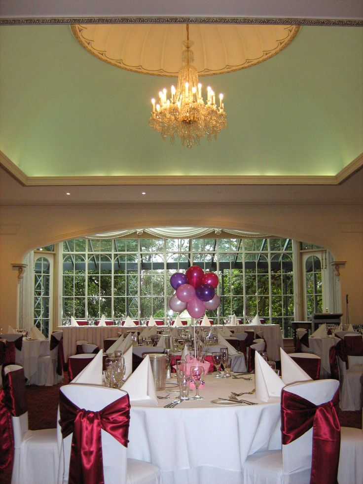 Reception setup with burgundy sash 39 s and baloon for Burgundy dining room ideas