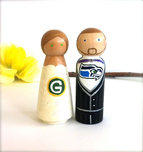 Seattle seahawks and green bay packers wooden wedding cake for Green bay packers wedding dress