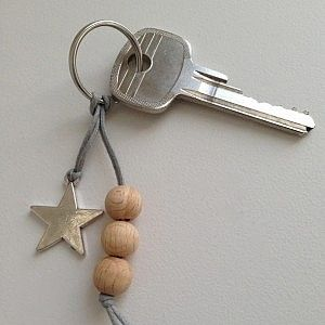 "Inspiration: ""Simple Star"" keyring with metal star, grey wax cord and wooden beads. From Simpel & Leuk."