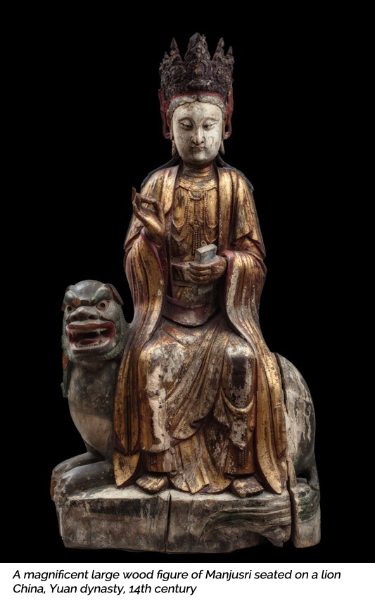 A magnificent large wood figure of Manjusri seated on a lion. China, Yuan dynasty, 14th century