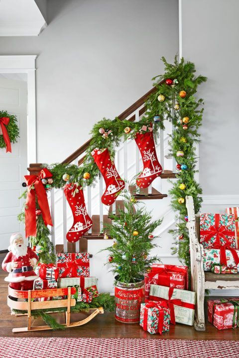 """Jenni adds sentimental sparkle with shiny baubles. """"I think it's so much more interesting when pieces come with a history,"""" says Jenni, who livens up greenery in the entryway with the 1950s favorites. (Imagine all the Christmases they've seen!) """"They set a magical tone the moment you walk in the door."""""""