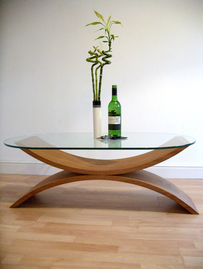 Reflections coffee table, curved wooden base with glass top by Chipp Designs.  Contemporary furniture