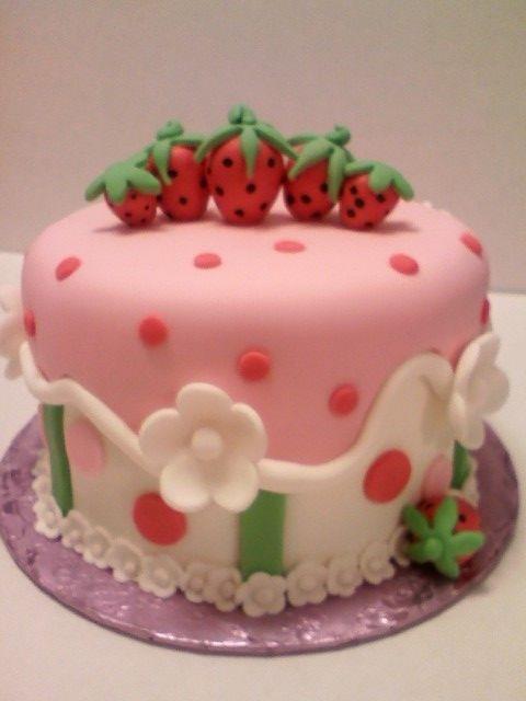 Cake covered in fondants. Strawberries