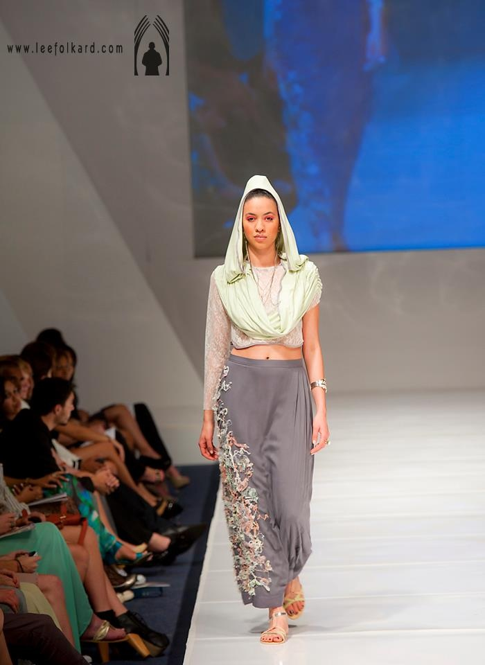 grey maxi skirt with ripped fabric and pleat detail with a lace cropped top and green draped hoody