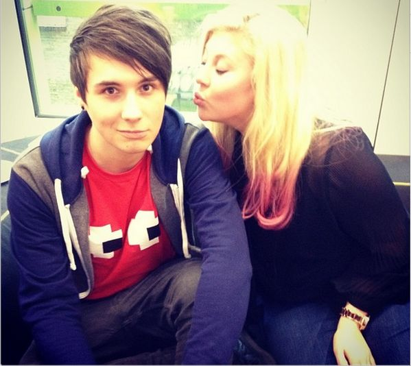 Louise get your lips away from Phil's man. Only he can touch Dans cheeks