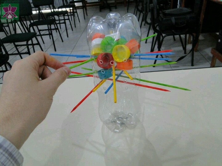No link.       Recycle two pop bottles, some lids, and paint a few skewers to make your own versioon of kerplunk!