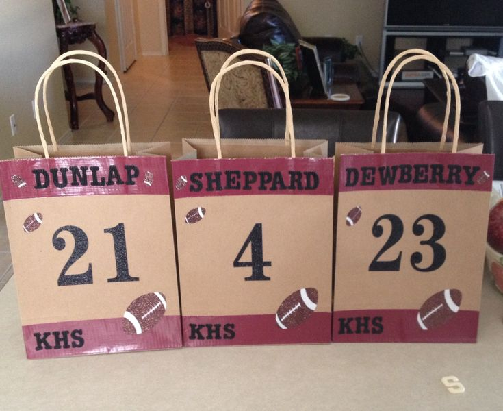 Simple gift bags for your football payer(s)! -Brown paper gift bag -School color Duct Tape -Letter stickers (different patterns: their last names are like a cardboard sticker and the numbers are glitter) -Football stickers -then their favorite snacks and Gatorade