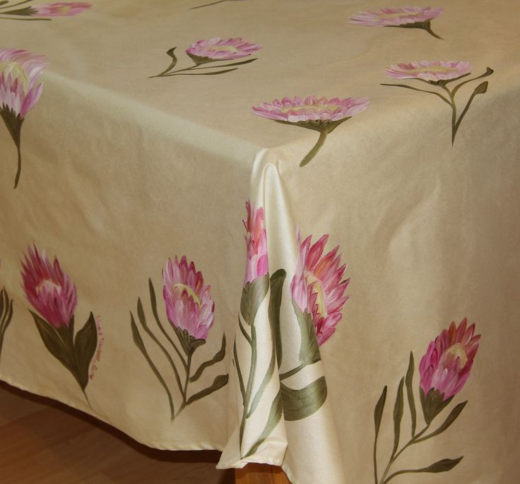 Hand painted table cloths by Dana Protea on a creamy gold background www.dmgdesigns.co.za or Facebook  DMG Designs.