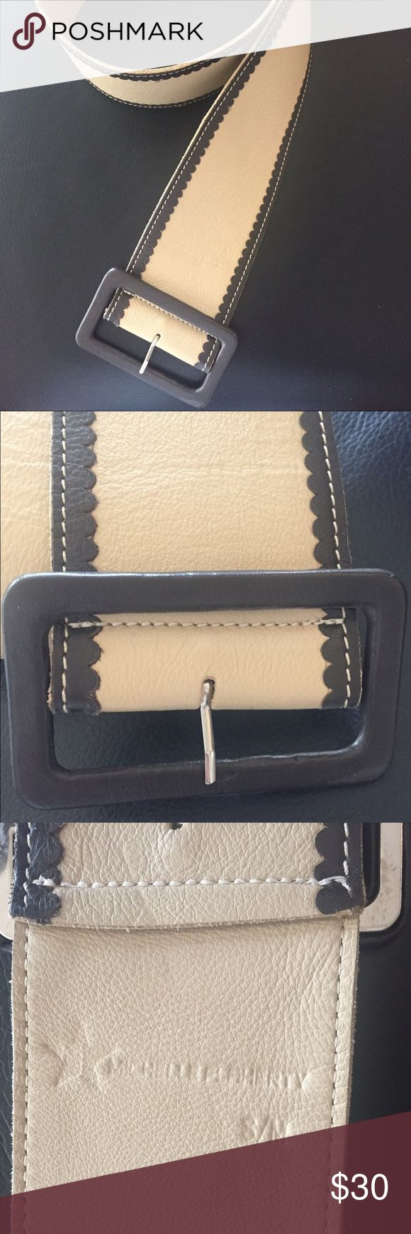 Gorgeous brown and tan leather belt s/m Very soft leather belt- worn once or twice. Like new. Small imperfection on the inside of the belt-noted in pictures. I can't make out the name of the designer, so I've included a picture . Maybe you'll recognize or can make it out. Accessories Belts