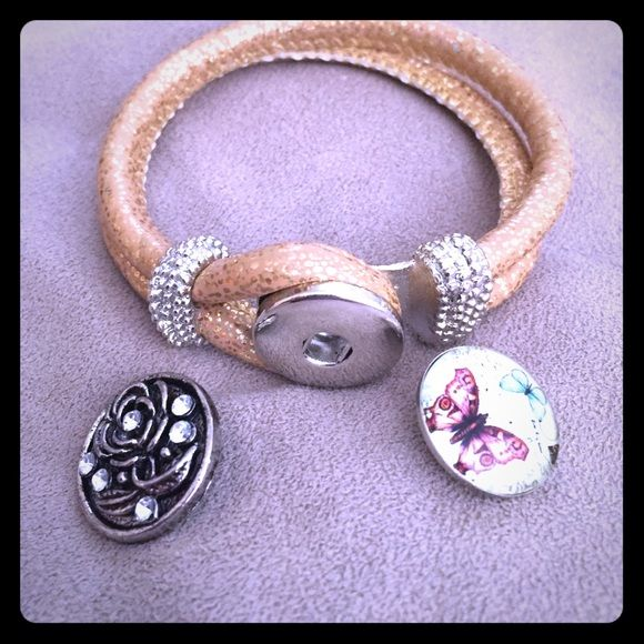2in1 Gold Button Bracelet Gold rope bracelet comes with two button snaps one glass butterfly picture and one flower with crystals. Brand new never worn. Jewelry Bracelets