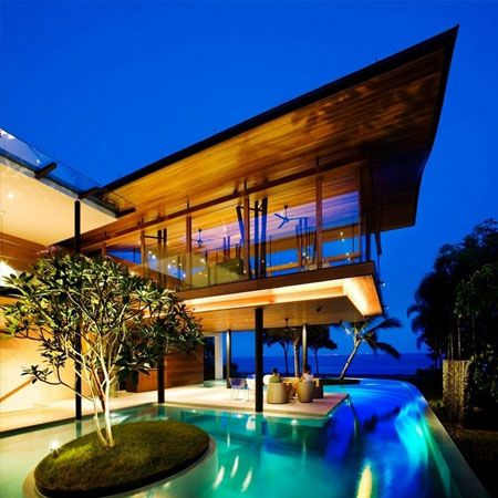 fish house located in singapore designed by guz architects this environmentally friendly seafront house embraces singapores tropical climate by creating