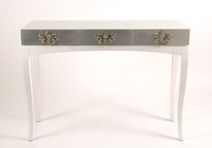 Trinity White Console Table by Boca do Lobo   Trinity is a unique console that features remarkable detailing and style. Its beautiful lines make it appropriate in any modern home decor and in any room setting   Discover more about Soho Collection: www.bocadolobo.com