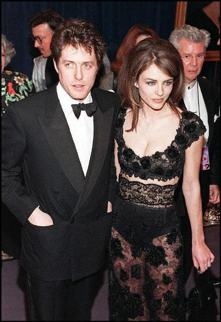 Elizabeth Hurley and Hugh Grant in February 1997 at an event honouring Elizabeth Taylor