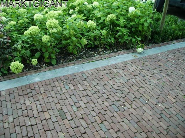 Oude hardgebakken waaltjes, geweldig als we daar onze tuin mee kunnen bestraten... Tja die prijs he..