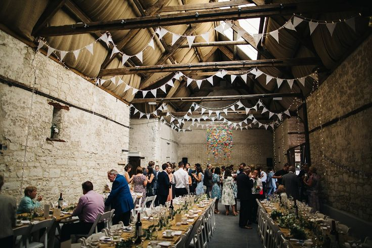 A rustic Dorset barn wedding with paper cranes. Photography by Richard Skins.
