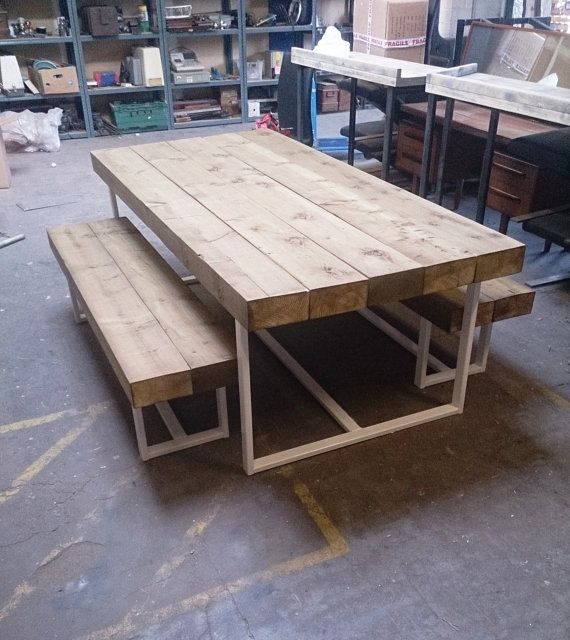 This is our new dining table The top is made from 20x10 cm Thick Timber sleepers They have sanded smooth and coated in an special wax solution which