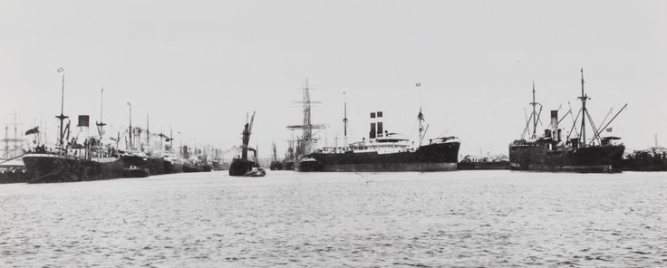 Black and white photograph of cargo ships in the water at Victoria Dock, 1920-1939. It is one of a collection of fifteen black and white photographs showing passenger and cargo ships in Australian waters in the 1920s and 1930s.