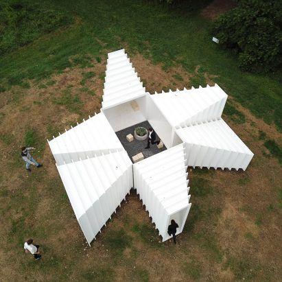 Angular white Zoid pavilion frames views across Ne…