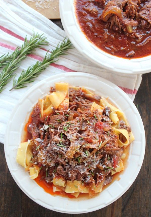 Slow Cooked Beef Ragu 1 large onion (sliced) 4 garlic cloves 2 tbsp fresh rosemary (chopped) 2 lb beef chuck roast 1 tsp kosher salt 1 tsp black pepper 2 cups beef broth ¼ cup red wine 1 can (6 oz) tomato paste 1 can (15 oz) diced tomatoes 12 ounces pappardelle pasta or polenta ½ cup Parmesan cheese (grated) Instructions