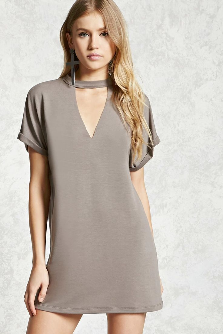 A soft mini T-shirt dress featuring a high-neck with a geo raw-cutout front, short dolman sleeves with rolled cuffs, and a shift silhouette.