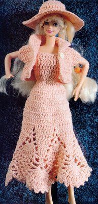 Barbie is going out without Ken, again! in a nice pink dress that has a diagram - Vestido rosa a crochet   labores de esther. todo para barbie