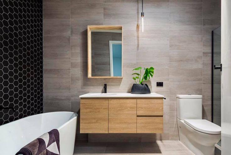 Bathroom B L I S S 💕 Using our black hexagon tiles as the feature to the bathroom #bathroomtiles #featuretiles