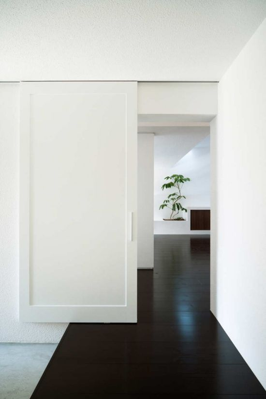 Sliding door inside the Gable House by Japanese architecture office FORM/Kouichi