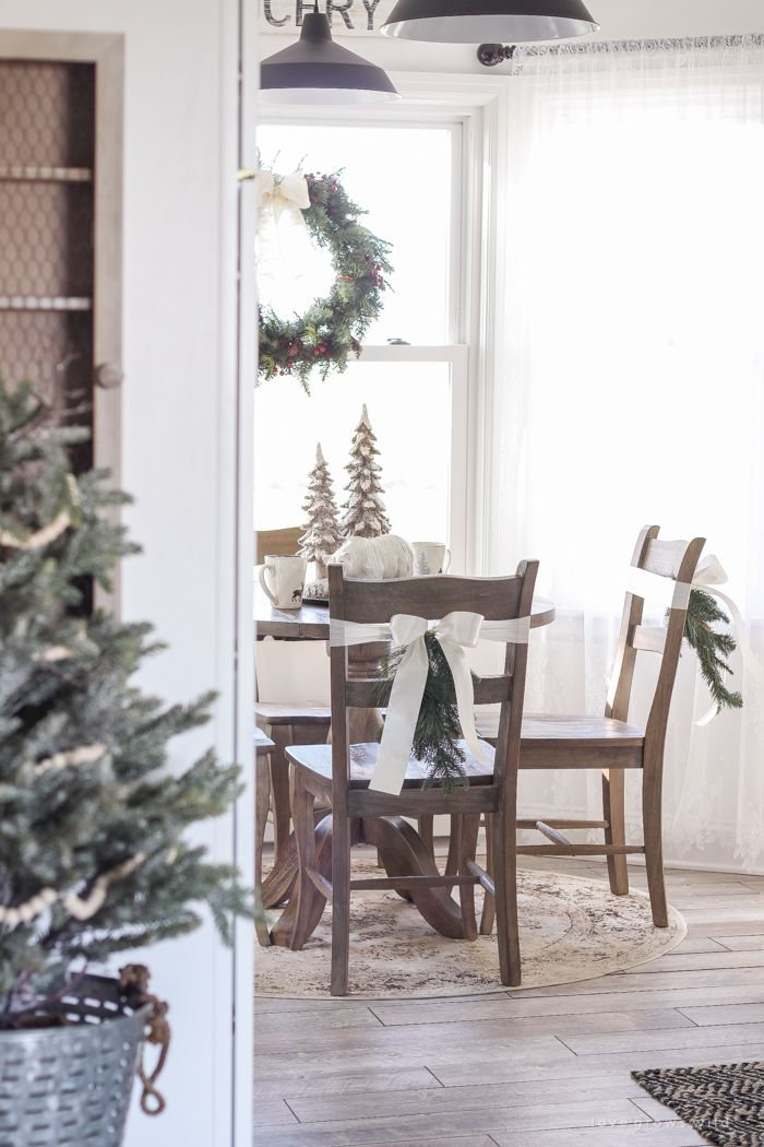 Step inside this beautiful farmhouse and discover a winter wonderland themed kitchen decorated for Christmas with simple touches of greenery and winter charm!