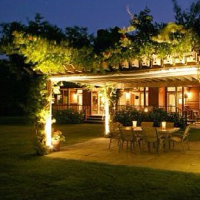 Vine covered pergola - concrete bottom, lights on the poles... not sure if I could grown the vines in our climate though