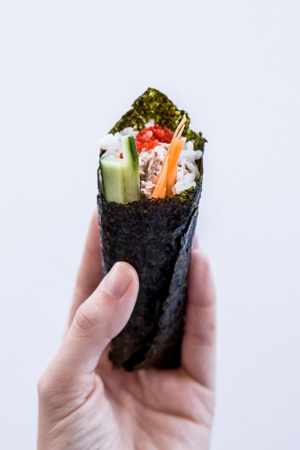"Temaki Sushi (Easy Hand-Rolled Sushi) Recipe - Temaki sushi is a fun and easy way to make sushi at home. Also known as ""hand-rolled"" sushi, it's made by wrapping nori seaweed around sushi rice and your favourite fillings to form a cone shape. 