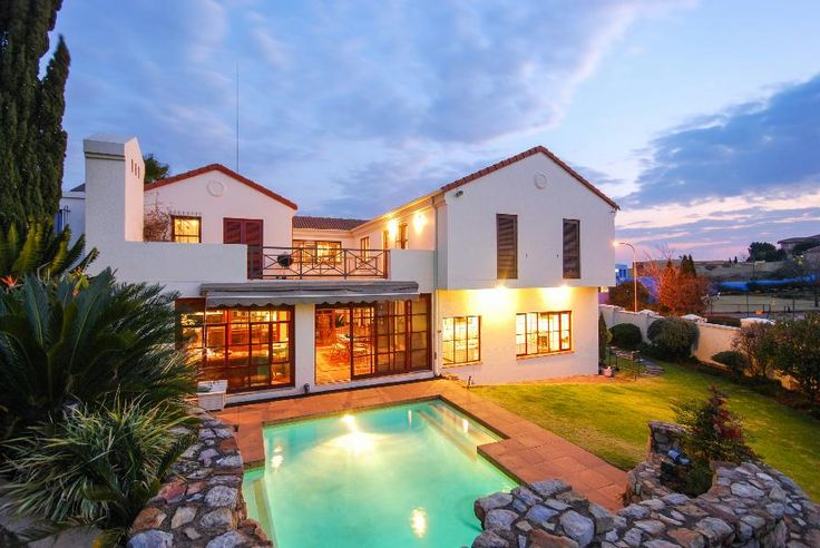 ESCAPE TO CANCUN  Northern view from wooden deck overlooking the pool area and garden. Stylish and tranquil. Fabulous open plan design with desert inspired central court.  #northcliff #johannesburg #pamgolding