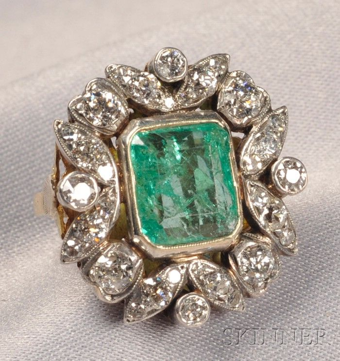 Emerald and Diamond Ring, bezel-set with an emerald-cut emerald measuring approx. 10.50 x 9.50 x 4.60 mm, framed by old European, full, and single-cut diamonds, approx. total diamond wt. 1.50 cts., silver-topped 18kt gold mount. Possibly Victorian