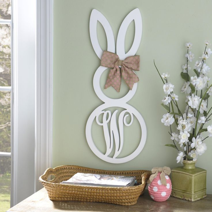 With a clean white finish, adorable bunny design, burlap bow and scripted monogram, this wooden wall plaque is perfect for Easter and the spring season!