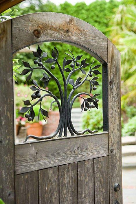 Iron fruit tree insert in wooden garden door.  | followpics.co