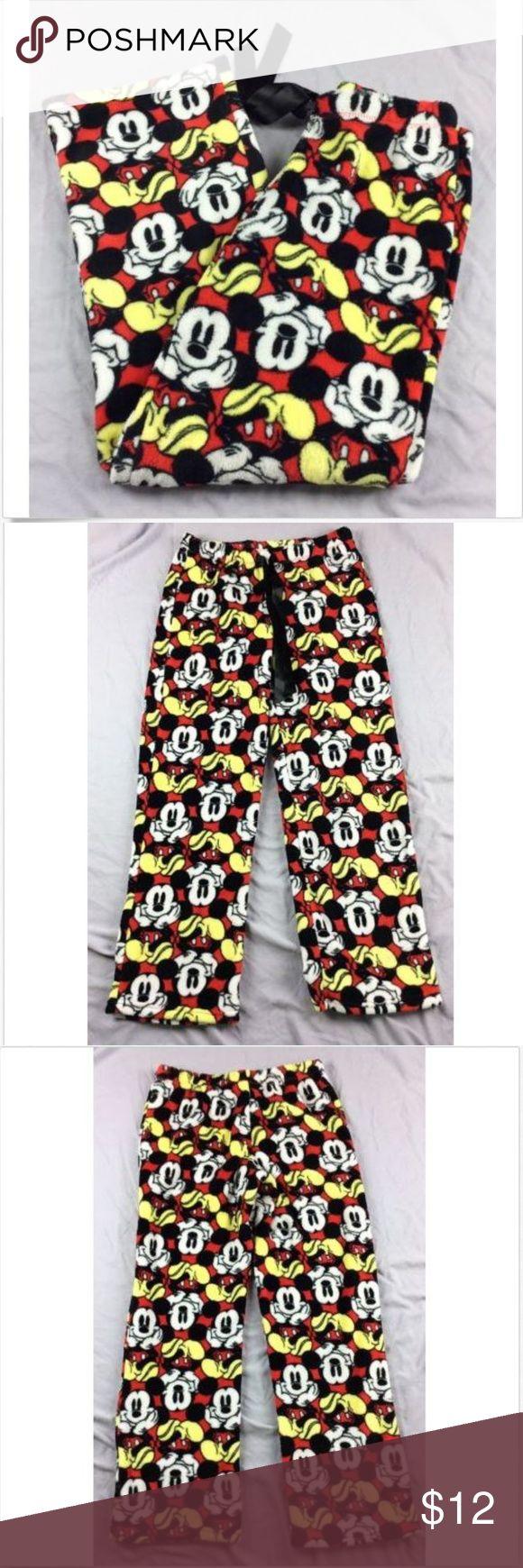 "Disney Mickey Mouse Polar Fleece Pajama Pants SM Disney Mickey Mouse pajama pants size small. Elastic drawstring waist, polar fleece  Measurements laying flat   Waist 14.5""  Hip 19""  Rise 9""  Inseam 28"" Disney Intimates & Sleepwear Pajamas"
