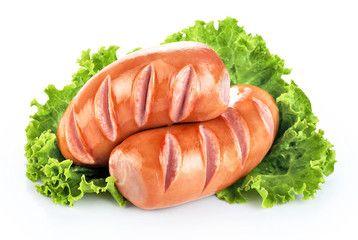 Fried sausages with lettuce isolated on white background.
