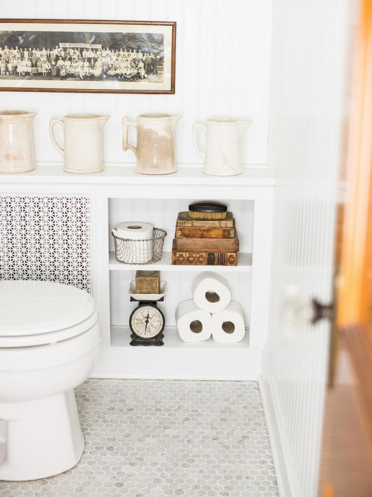 A DIY radiator cover adds style and storage this this quaint cottage bathroom.