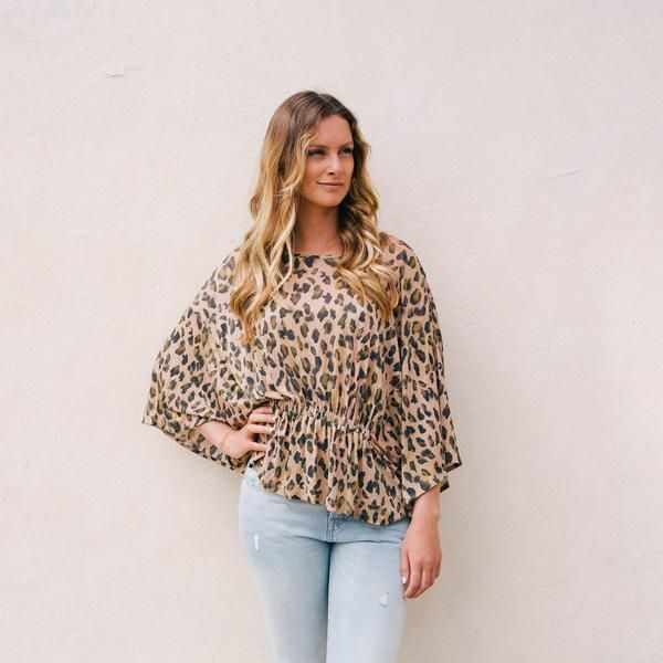 This animal print top features a gathered waistband, round neck and batwing sleeve for a super flattering look! Eligible for free UK standard delivery.