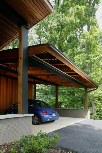 Carport beams black one side, cedar on other side