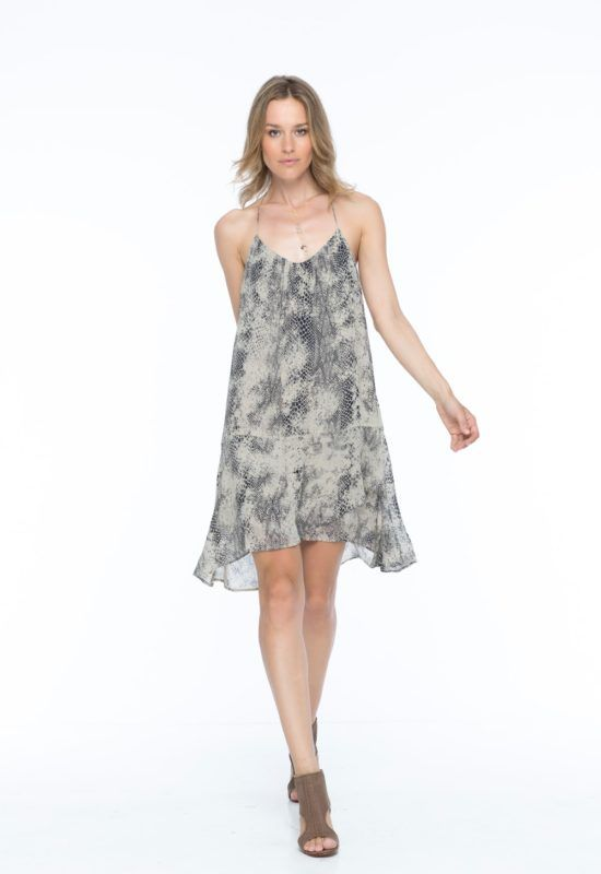 MAYA LILY DRESS -- A strappy halter dress with a sexy back in a shapeless silhouette. Large ruffles on the front and back brings movement to the dress as it easily transitions from day to night.