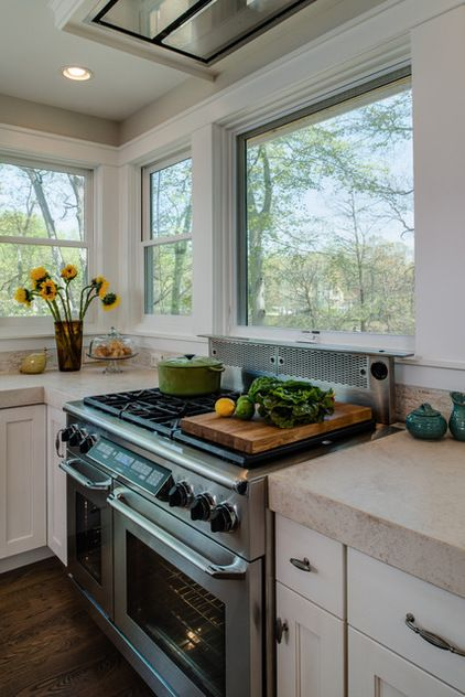 If you want uninterrupted views, consider a downdraft vent at the range in combination with a ceiling-mounted hood ...