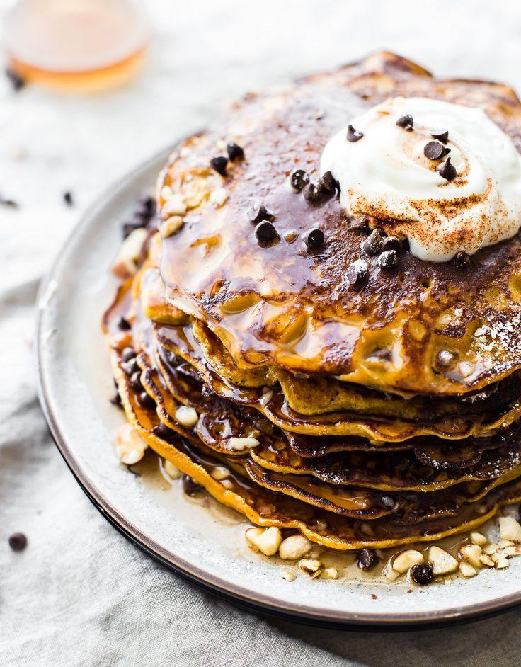 "A Flourless Carrot Cake Yogurt Pancakes recipe that's perfect for breakfast or brunch. These Flourless Carrot ""Cake"" Yogurt Pancakes are too good to be true! Made with siggi's vanilla yogurt, making them lower in sugar, gluten free, and protein packed! An easy blender recipe."