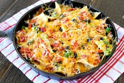 To make Pizza Nachos: tortilla chips, onion, pepperoni, black olives, green pepper, and Colby Jack cheese. Melt 1 tbs butter and 1/2 tbs oil, add 3 minced garlic, raise heat and add 1/2 cup cream and 1/4 cup milk. When it boils add salt, pepper, chilli flakes and 1/4 cup parmesan, stir until thickened. Drizzle over nacho chips, then top with diced onion, pepperoni pieces, sliced black olives, diced green pepper; sprinkle 1 cup grated cheese over. Bake at 400F for about 7 minutes. | Tasty…