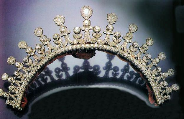 "Another nice tiara, originally Thurn und Taxis, sold in '92 to pay death duties, then sold again, I believe, in 2005. The pear diamonds on top are detachable. The sketch of the Furstin Margarethe Clementine, Duchess of Mecklenberg-Strelitz (married Erbprinz Carl Alexander von Thurn und Taxis, who succeeded his father as Fürst in 1805) calls wearing a tiara as a hair ornament the ""Napoleonic style"" followed even after the Bourbon restoration in 1815"
