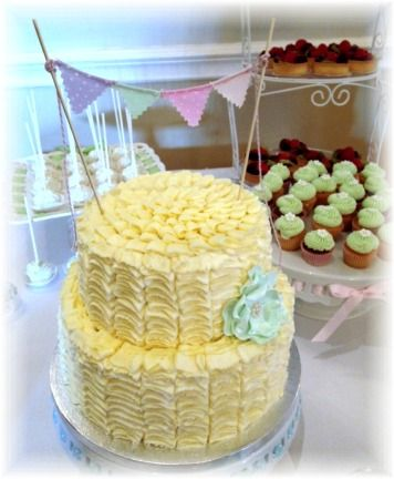 Ruffle buttercream icing wedding cake with hand made sugar fantasy flower and fabric bunting