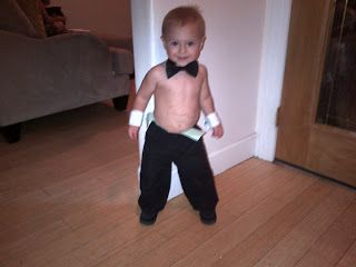 homemade kids costume: Chipendale dancer with french cuff link cuffs, bow tie, and monopoly money stapled to the waistband of black pants