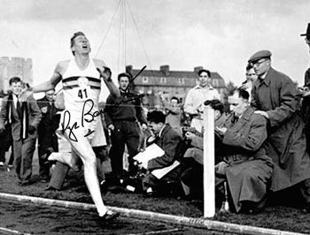 SIR ROGER BANNISTER  (First sub 4 min miler in 1954) Signed photo crossing the finishing line to record the first sub four minute mile at Iffley Road, Oxford in 1954.