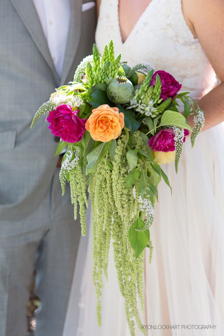 cascading bridal bouquet with amaranthus and garden roses in magenta and orange. photo: Ryon:Lockhart Photography