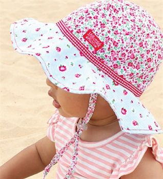 This gorgeous baby girls hat you will find. It is fully reversible 100% cotton. One side has a floral print around the crown and a rose and blue stripe print on the brim. The second side has the rose and blue stripe print all over.