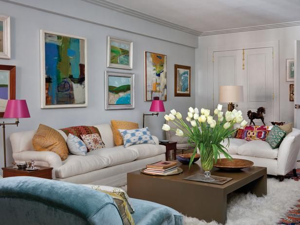 Eclectic Living Room With Flokati Rug and Colorful Artwork - on HGTV